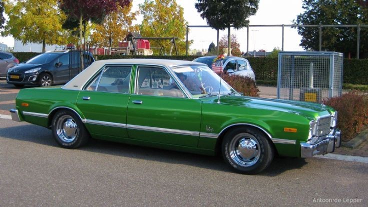 1976 green Plymouth Premier.