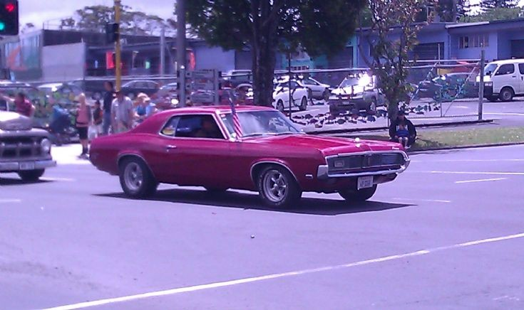 1968 Mercury Cougar with American flag.