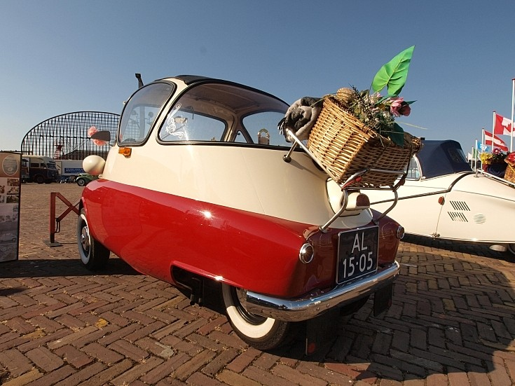 Rear view of a red and white BMW Isetta