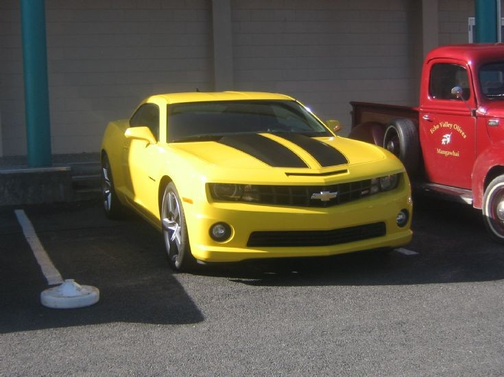 Rally Yellow/black striped 2010 Chevrolet Camaro SS.
