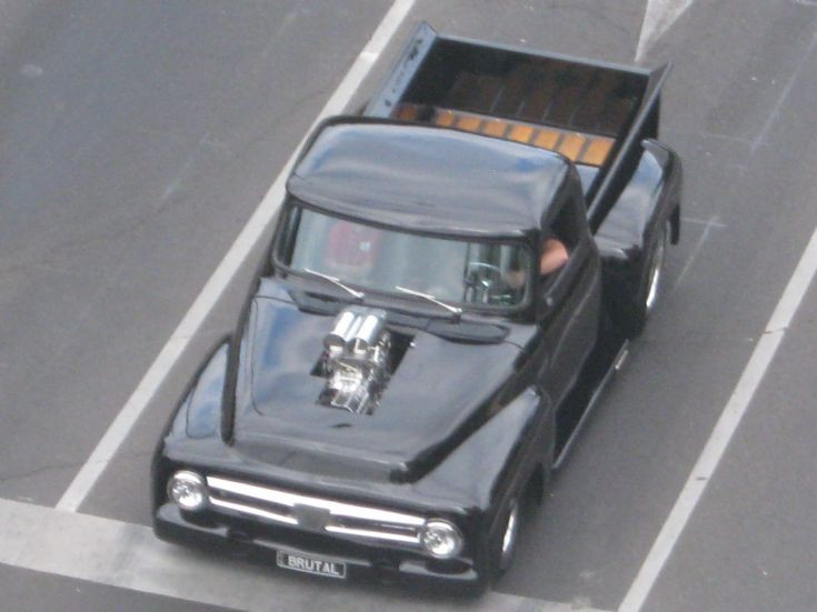 custom Ford F100 with blower sticking out bonnet.