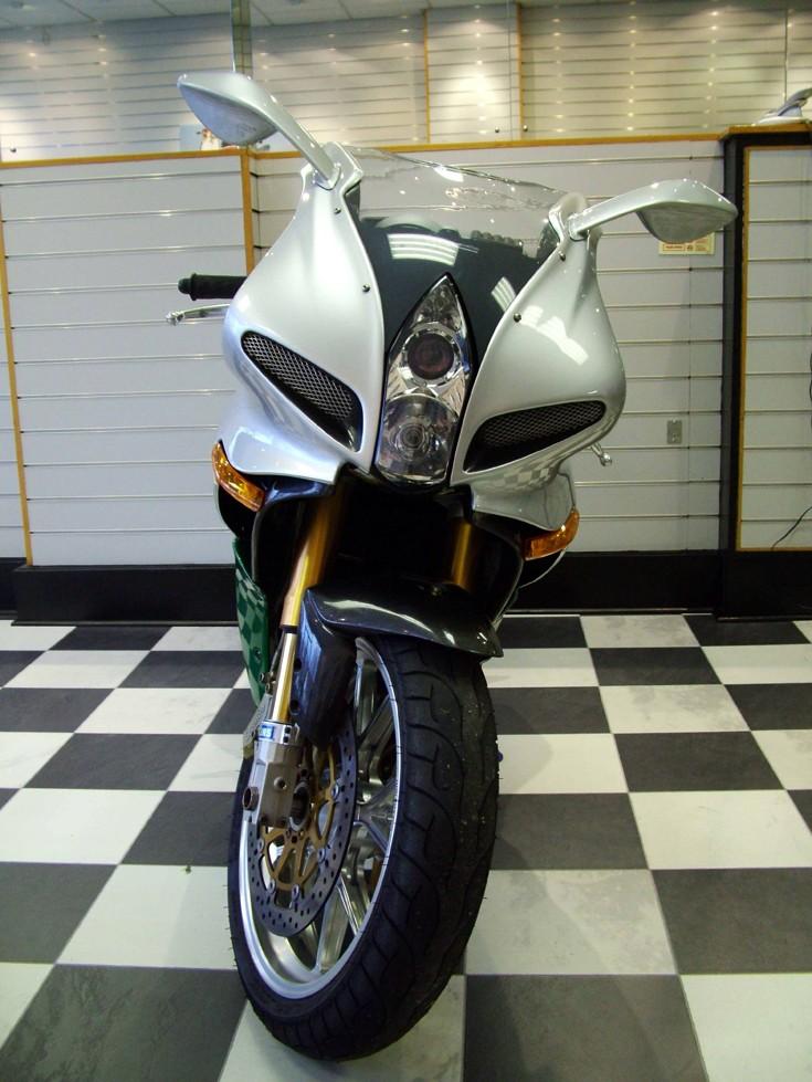 Green & silver Benelli bike