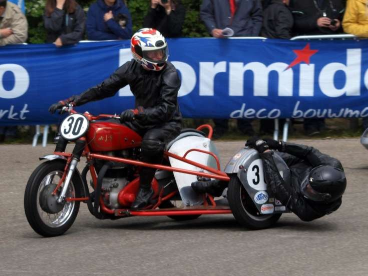Racing with a classic AJS and sidecard