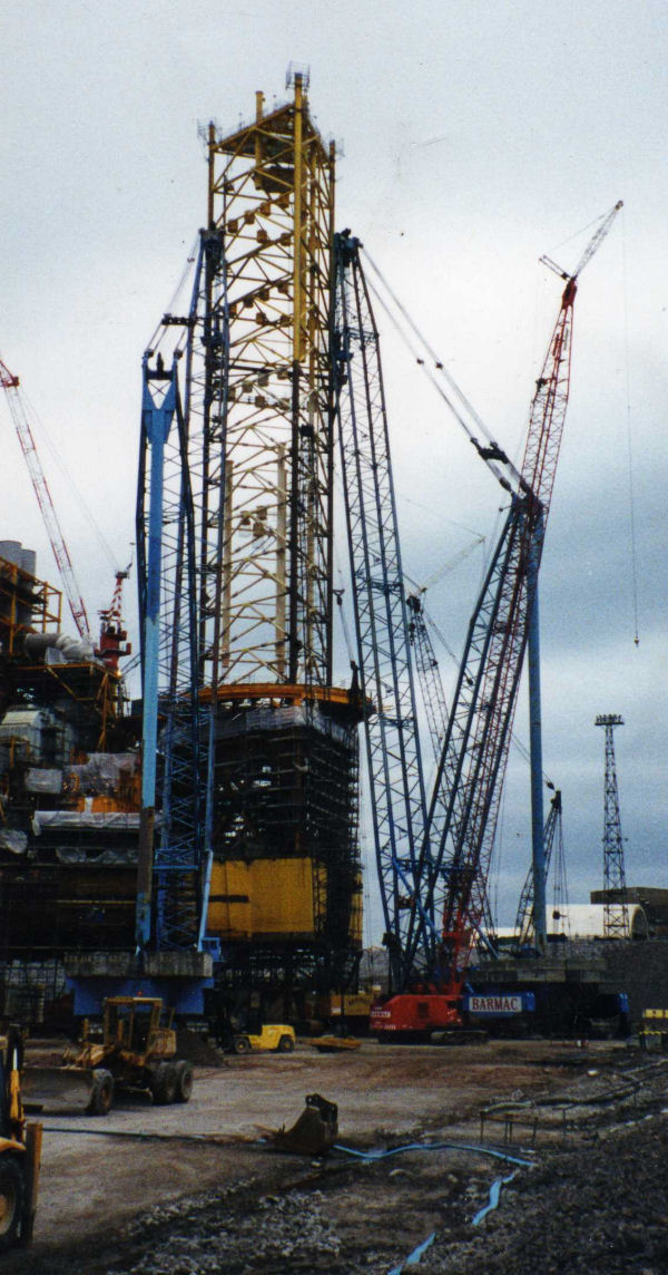 Two Lampson cranes lifting leg section on Elf Elgin