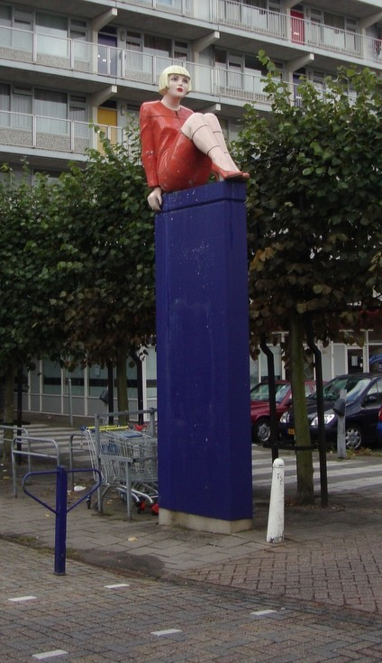 Woman on pillar