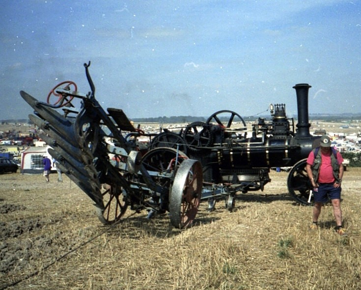 Ploughing engine and plough